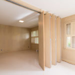This room can be 1 or 2 bedrooms with the handy wooden room separator.
