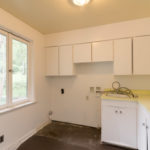 Utility room is just off the garage with an exterior door to the backyard.