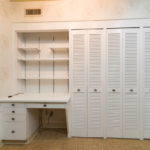 The kitchen also has this large pantry for your convenience and a built in desk for your household needs.
