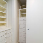 The master bath has two walls of closets with amazing built ins.