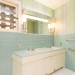 Blue tile, double vanity and combo tub/shower in the master bath.