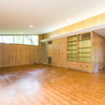 The open living room has spacious built ins, parquet floors and wood burning fireplace.