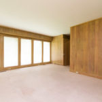 The paneled study with a wall of windows along with a full bath just off the entry.