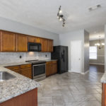This beautiful kitchen has been renovated with granite countertops and stainless appliances.