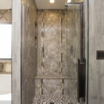 The totally renovated master bath includes this beautiful glass shower and garden soaking tub.