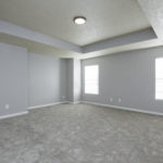 Moving upstairs, the master bedroom elegance is evident in the trey ceiling, new carpet and designer paint colors.