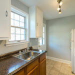 This secondary kitchen also has a separate entrance.