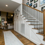 Beautiful staircase to upper level with elegant wooden stair treads.