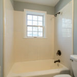 The full bath which is just outside the bedroom and would serve as guest bath for the family gathering area.
