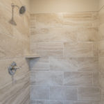 This gorgeous walk-in shower includes glass door.