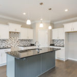 The beautiful kitchen comes with an appliance allowance for the new owner!