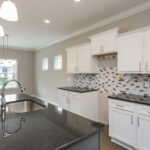 Great touches throughout the house will pop out at you like the gorgeous tile backsplash.