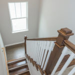 Heading upstairs, you will enjoy the beautifully crafted wooden steps.
