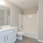 The upper level bedrooms share this full bath.