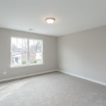 The secondary bedroom on the upper level has carpeted floors for maximum quiet.