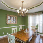 The formal dining room with chair rail and bay window is spacious enough for all your family gatherings.