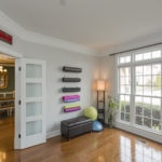 This front sunny room is currently being used as a yoga room and would also be great as a home office.