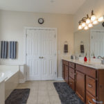 Double vanity and walk in closet in the master bath.