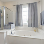 Jetted tub and glass shower complete the master en suite bath.