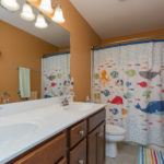 The full bath upstairs is shared by all three additional bedrooms with combo tub/shower.