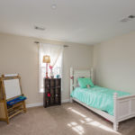 The third additional bedroom is located on the back of the house and also has a walk in closet.
