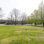 This listing includes the additional lot shown here for a total of 1.2 acres.