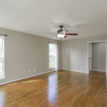 The spacious living room has lots of natural light.