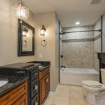 The master bath is en suite with beautiful granite countertops, tile surround combo tub/bath and tile floors.