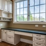 Just off the kitchen tucked away across from butler's pantry is this cute home office with large desk space and plenty of storage.