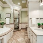 The master bath has heated tile floor and gorgeous stone countertops, double vanity, glass shower with rain showerhead & garden tub for your oasis away to relax from the hectic day.