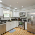 Tons of cabinets and a full pantry for storage along with stainless appliances make this a chef's dream.