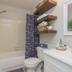 The full bath shared by the secondary bedrooms is also the guest bath.