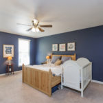 The master bedroom is painted a relaxing blue. The room measures a huge 17 x 14 feet and has great closet space.
