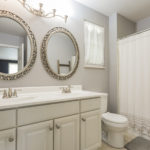 The en-suite master bath has double vanities and a combination tub-shower.