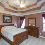The master bedroom and its beautiful trey ceiling are tucked in the back of the house for peace & quiet to rest.