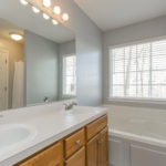 The master bath has double vanity and large walk in closet.