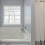 The jetted tub and separate shower complete the spa-like oasis of this master bath.