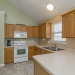 Spacious kitchen with gleaming white appliances for the chef in your family.