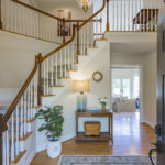 Welcome your guests in this elegant foyer featuring a Southern curved staircase.
