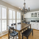 The breakfast area hosts an abundance of light that comes through these handsome plantation shutters.