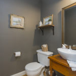 The half bath is located near the living room for your guests' convenience.