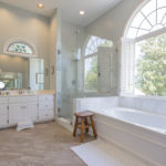 The gorgeous, en suite master bathroom has a large soaking tub & glass shower, double vanity and lots of natural light.