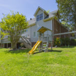 The backyard is fully fenced and has more than enough space for outdoor activities.