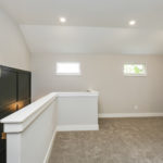 Heading upstairs, this spacious landing would be a great spot for another familly gathering area.