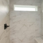 Love this walk-in shower with frameless glass door.