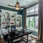 The office/library is just off the foyer for your convenience and has gorgeous built-ins for all your first editions.