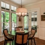 The breakfast nook enjoys sunny windows to brighten your mornings.