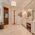 Master bath suite has double vanity, stand alone tub and tiled shower with a massive master closet for both.