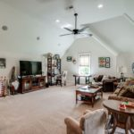 This house is made for entertaining with multiple living areas including this enormous bonus room over the garage with wet bar.