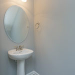Guests will enjoy the powder room with pedestal sink.(Photo of Unit 108)